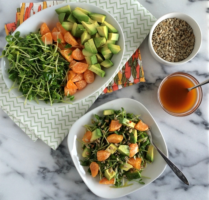 Pea shoots, oranges, and avocados with orange-chili vinaigrette