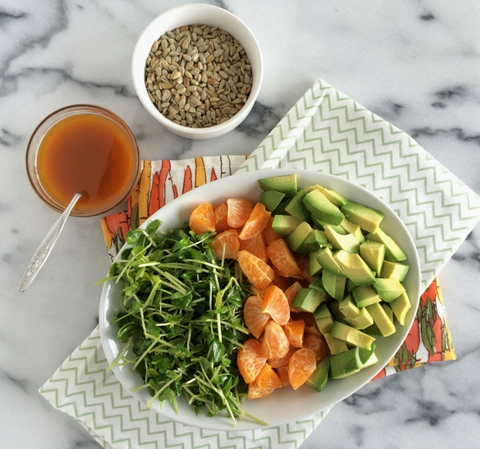 Pea tendrils, oranges, and avocados with orange-chili vinaigrette